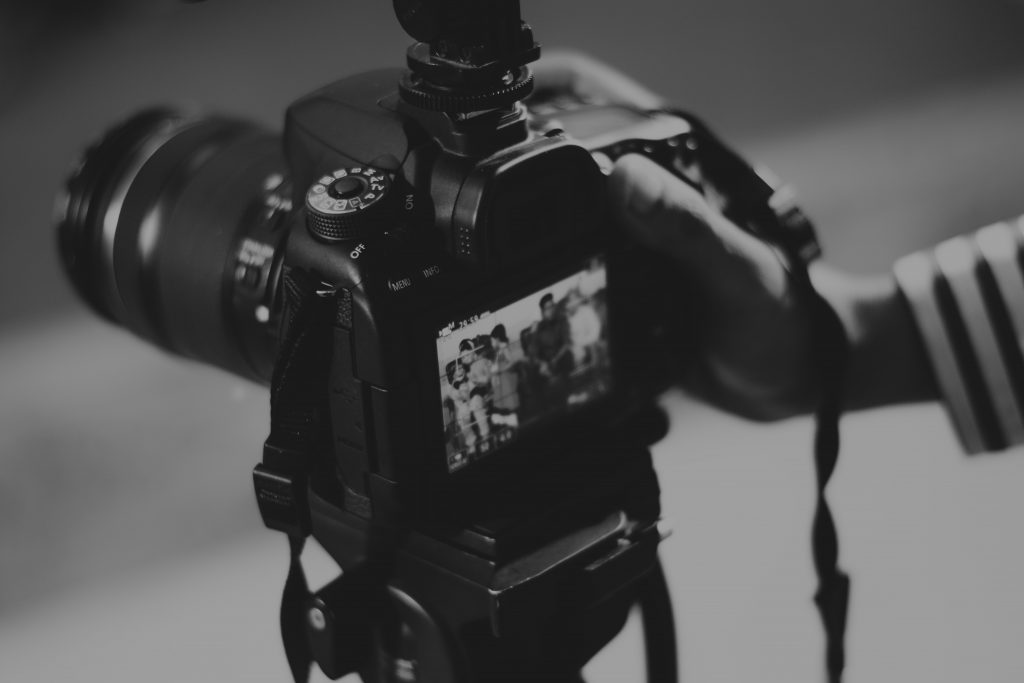black and white photo of a DSLR camera
